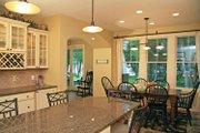 Craftsman Style House Plan - 3 Beds 3.5 Baths 3136 Sq/Ft Plan #928-54 Interior - Dining Room