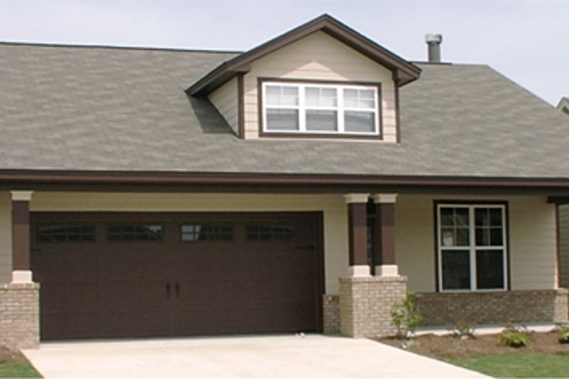 Bungalow Style House Plan - 3 Beds 2 Baths 1817 Sq/Ft Plan #63-242 Exterior - Front Elevation