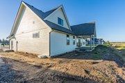 Farmhouse Style House Plan - 4 Beds 3 Baths 2286 Sq/Ft Plan #1070-127 Exterior - Rear Elevation