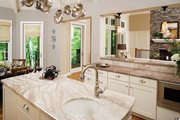 Craftsman Style House Plan - 4 Beds 4 Baths 3014 Sq/Ft Plan #929-937 Interior - Kitchen