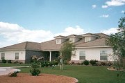 Ranch Style House Plan - 5 Beds 5.5 Baths 5068 Sq/Ft Plan #1-933 Exterior - Front Elevation