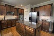 Craftsman Style House Plan - 4 Beds 3 Baths 2644 Sq/Ft Plan #927-25 Interior - Kitchen