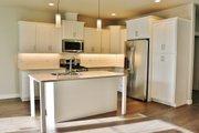 Craftsman Style House Plan - 3 Beds 2.5 Baths 2187 Sq/Ft Plan #1070-50 Interior - Kitchen