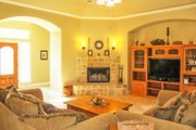 Mediterranean Style House Plan - 4 Beds 2 Baths 2014 Sq/Ft Plan #80-142 Interior - Family Room