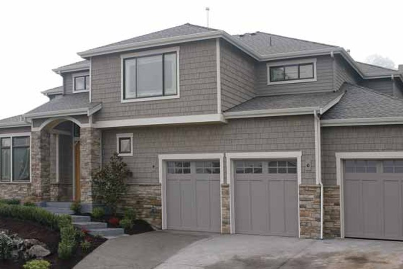 Contemporary Exterior - Front Elevation Plan #951-10 - Houseplans.com