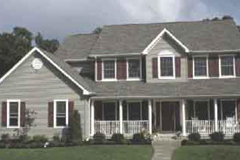 Farmhouse Exterior - Front Elevation Plan #20-2016 - Houseplans.com