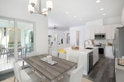 Beach Style House Plan - 3 Beds 2.5 Baths 1830 Sq/Ft Plan #938-108 Interior - Dining Room