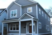 Traditional Style House Plan - 3 Beds 2.5 Baths 2674 Sq/Ft Plan #1057-13 Exterior - Front Elevation