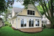 Bungalow Style House Plan - 3 Beds 2 Baths 1943 Sq/Ft Plan #928-191 Exterior - Rear Elevation