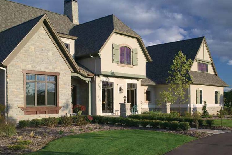 European Style House Plan - 4 Beds 3.5 Baths 5107 Sq/Ft Plan #928-66 Exterior - Front Elevation