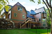 Craftsman Style House Plan - 3 Beds 2.5 Baths 3477 Sq/Ft Plan #928-244 Exterior - Rear Elevation