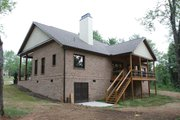 Country Style House Plan - 3 Beds 2.5 Baths 2170 Sq/Ft Plan #927-150 Exterior - Rear Elevation