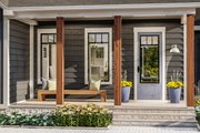 Country Style House Plan - 3 Beds 2 Baths 1936 Sq/Ft Plan #406-9659 Exterior - Covered Porch