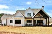 Farmhouse Style House Plan - 4 Beds 4 Baths 2545 Sq/Ft Plan #927-990 Exterior - Rear Elevation