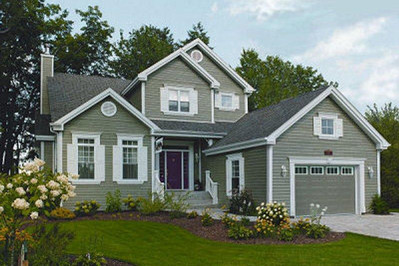 Farmhouse Exterior - Front Elevation Plan #23-722 - Houseplans.com