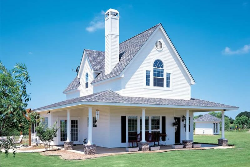 Farmhouse Exterior - Front Elevation Plan #410-123 - Houseplans.com
