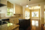 Country Style House Plan - 3 Beds 2.5 Baths 1929 Sq/Ft Plan #928-96 Interior - Kitchen