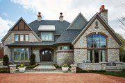 Tudor Style House Plan - 5 Beds 5 Baths 7398 Sq/Ft Plan #928-275 Exterior - Front Elevation