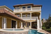 Mediterranean Style House Plan - 4 Beds 4.5 Baths 3138 Sq/Ft Plan #930-411 Exterior - Rear Elevation