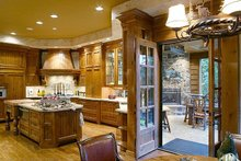 Dream House Plan - Kitchen with outdoor living access