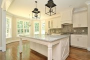 Country Style House Plan - 4 Beds 3 Baths 2419 Sq/Ft Plan #927-604 Interior - Kitchen