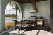 Mediterranean Style House Plan - 4 Beds 4.5 Baths 3682 Sq/Ft Plan #930-481 Exterior - Outdoor Living