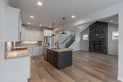 Craftsman Style House Plan - 3 Beds 2.5 Baths 1942 Sq/Ft Plan #1070-53 Interior - Kitchen