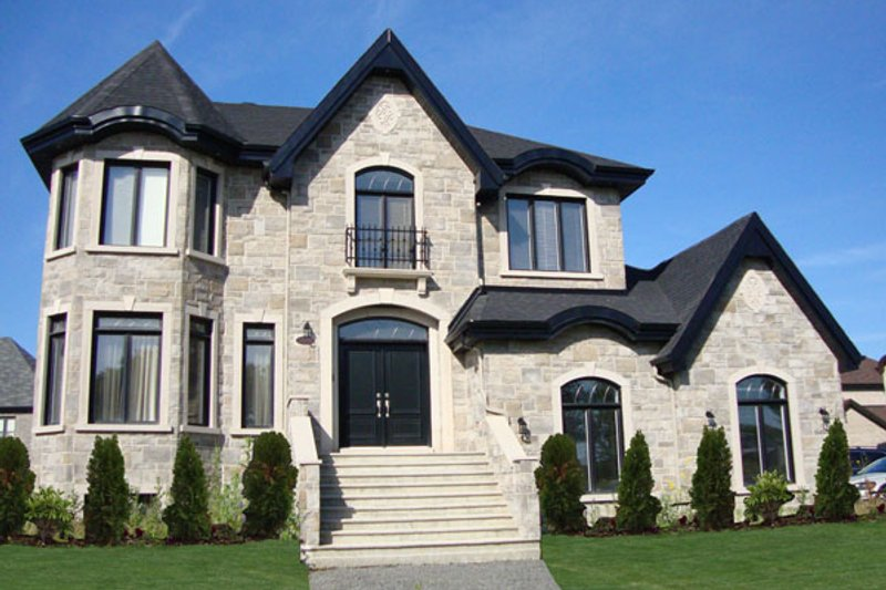 European Style House Plan - 4 Beds 2.5 Baths 3287 Sq/Ft Plan #138-384 Exterior - Front Elevation