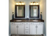 Country Style House Plan - 4 Beds 3 Baths 2304 Sq/Ft Plan #929-610 Interior - Master Bathroom