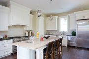 Traditional Style House Plan - 4 Beds 3.5 Baths 3677 Sq/Ft Plan #928-271 Interior - Kitchen