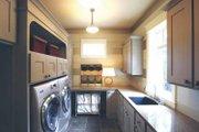 European Style House Plan - 4 Beds 3.5 Baths 4347 Sq/Ft Plan #928-178 Interior - Laundry