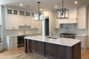 Traditional Style House Plan - 4 Beds 3.5 Baths 4366 Sq/Ft Plan #437-86 Interior - Kitchen
