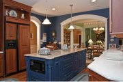 Tudor Style House Plan - 4 Beds 3.5 Baths 4940 Sq/Ft Plan #928-27 Interior - Kitchen