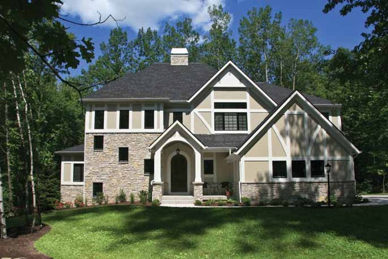 Tudor Style House Plan - 4 Beds 2.5 Baths 3203 Sq/Ft Plan #928-234 Exterior - Front Elevation