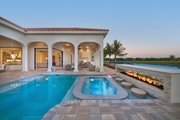 Mediterranean Style House Plan - 3 Beds 3.5 Baths 3877 Sq/Ft Plan #930-447 Exterior - Rear Elevation