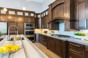 Modern Style House Plan - 5 Beds 4 Baths 5716 Sq/Ft Plan #920-18 Interior - Kitchen