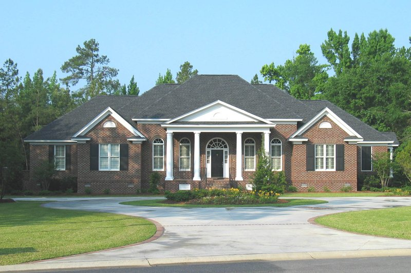 Colonial Style House Plan - 4 Beds 3.5 Baths 4348 Sq/Ft Plan #1054-60 Exterior - Front Elevation