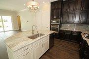 Mediterranean Style House Plan - 4 Beds 4 Baths 2693 Sq/Ft Plan #1058-147 Interior - Kitchen