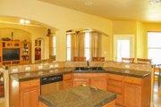 Mediterranean Style House Plan - 4 Beds 2 Baths 2014 Sq/Ft Plan #80-142 Interior - Kitchen