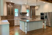 Craftsman Style House Plan - 4 Beds 3.5 Baths 3938 Sq/Ft Plan #437-103 Interior - Kitchen
