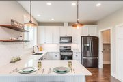 Craftsman Style House Plan - 3 Beds 2.5 Baths 2233 Sq/Ft Plan #1070-17 Interior - Kitchen