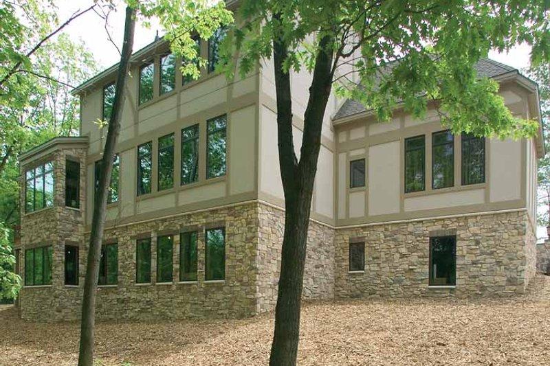 Tudor Style House Plan - 3 Beds 3 Baths 3586 Sq/Ft Plan #928-61 Exterior - Rear Elevation