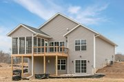 Ranch Style House Plan - 2 Beds 2 Baths 1354 Sq/Ft Plan #70-1482 Exterior - Rear Elevation
