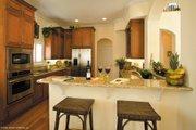 Mediterranean Style House Plan - 3 Beds 3.5 Baths 2374 Sq/Ft Plan #930-16 Interior - Kitchen