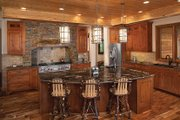 Log Style House Plan - 5 Beds 4.5 Baths 5140 Sq/Ft Plan #928-263 Interior - Kitchen