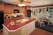 Country Style House Plan - 3 Beds 2 Baths 1787 Sq/Ft Plan #929-242 Interior - Kitchen