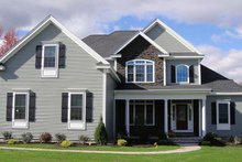 House Plan Design - Country Exterior - Front Elevation Plan #927-642