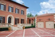Mediterranean Style House Plan - 5 Beds 5 Baths 7340 Sq/Ft Plan #1058-11 Exterior - Front Elevation