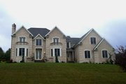 Traditional Style House Plan - 3 Beds 2.5 Baths 3327 Sq/Ft Plan #20-2300 Exterior - Front Elevation