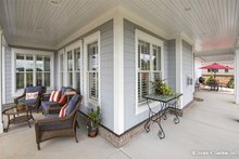European Exterior - Covered Porch Plan #929-859